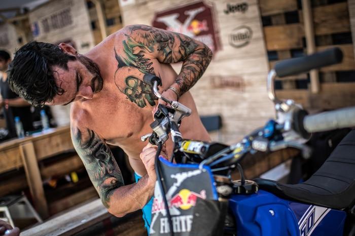 Adam Jones  working on his bike